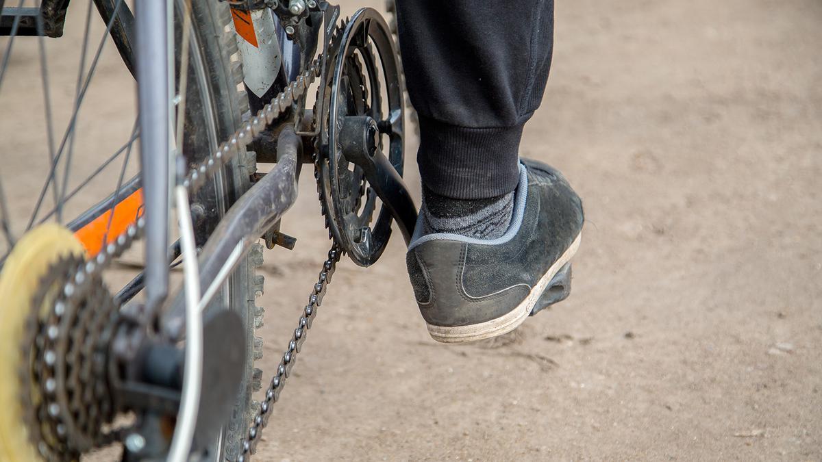 PEDALING BICYCLE